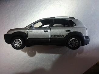 Hyundai Tucson JM,sc: 1:32,SM TOYS,made in Korea. Lexus iS 350,UNI Fortune,made in China/