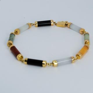 Золотой браслет с разноцветным ониксом