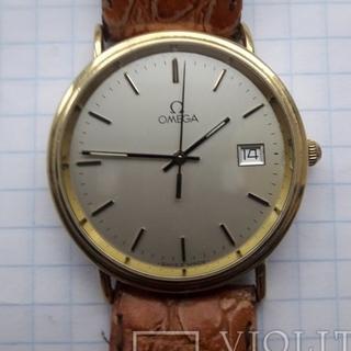 Золотые мужские часы Omega