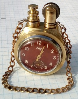 """Бензиновая зажигалка с механическими часами """" Свет """", клеймо."""