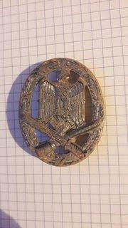 Нагрудний кваліфікаційний знак (За участь в общих штурмових атаках).