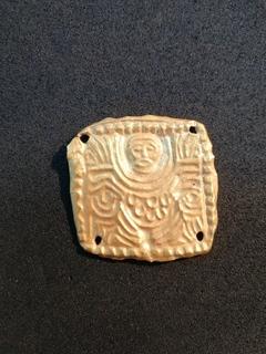 Скифская золотая нашивка с изображением Бога